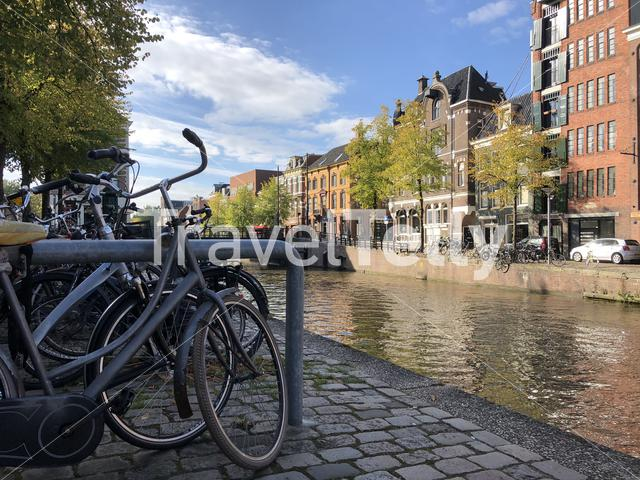 Bicycles next to a canal in Groningen The Netherlands