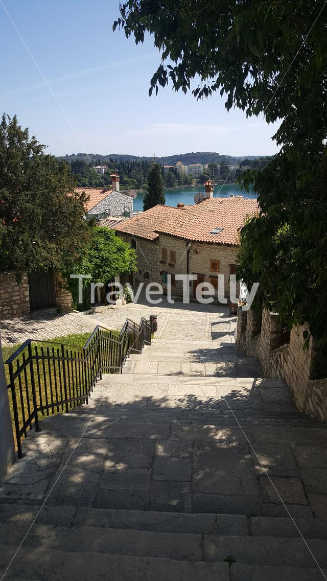 View over Rovinj from stairs in small alley