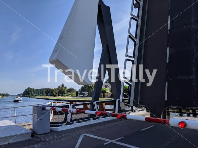 Canal bridge open for a boat passing by in Hardenberg, The Netherlands