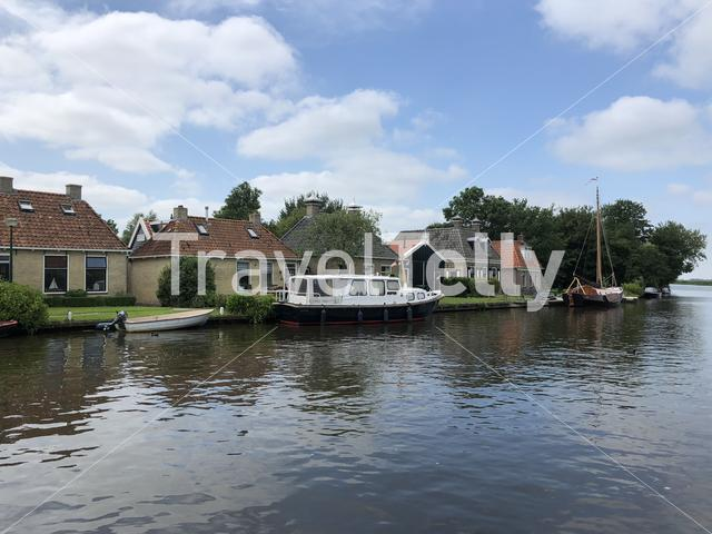 Houses next to a canal in Oosthem, Friesland The Netherlands