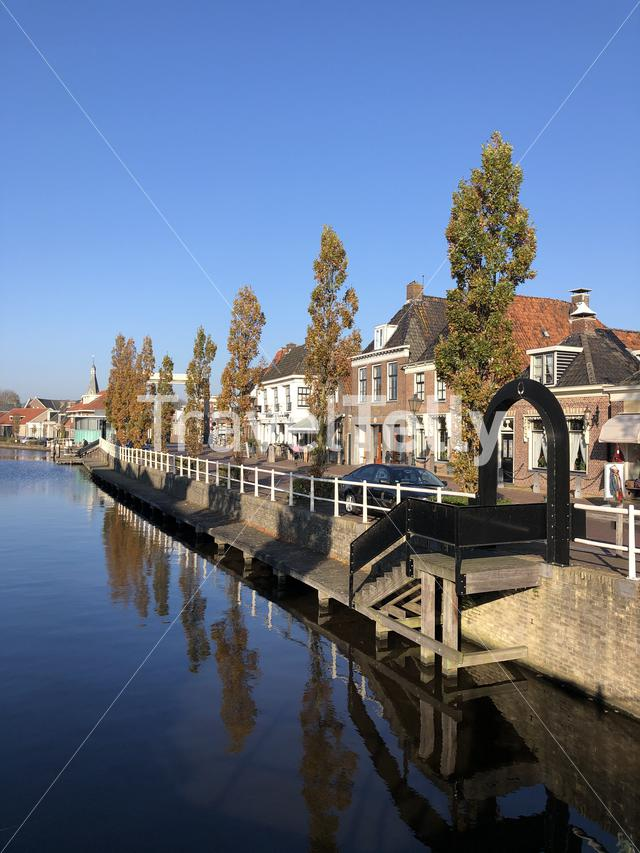 Canal in IJlst during autumn in Friesland, The Netherlands