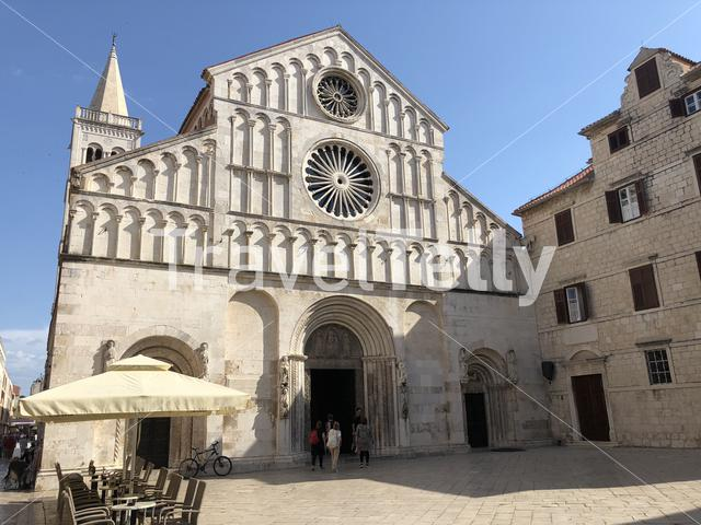 Tourists walking on to the Saint Anastasia romanesque cathedral in Zadar Croatia