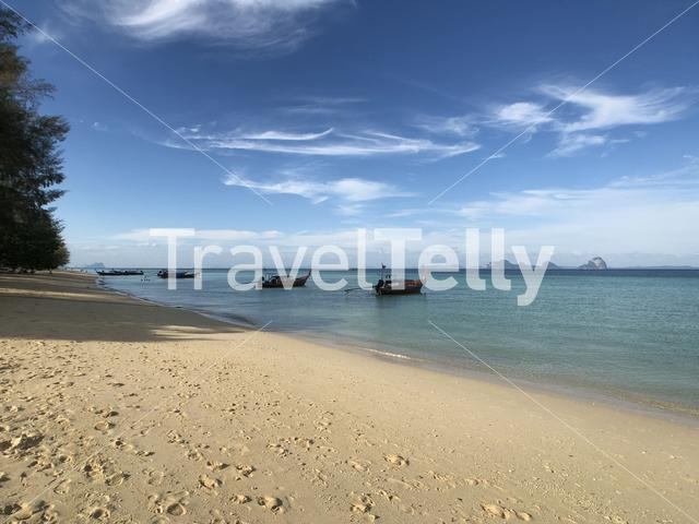 Long-tail boats in front of the beach of Koh Ngai  in Thailand