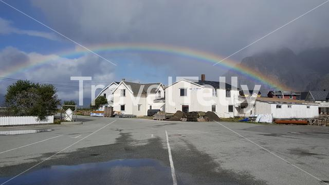 Rainbow above houses in Henningsvaer Norway