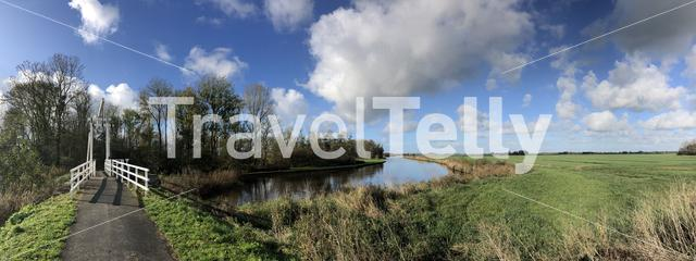 Panoramic from a bridge over a canal in a nature reserve around Wolvega in Friesland, The Netherlands