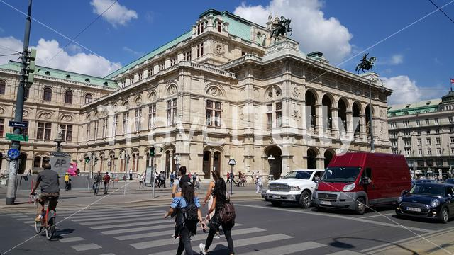 People walking in front of Vienna State Opera buidling