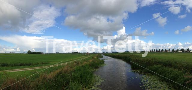 Panorama from farm land in Friesland The Netherlands