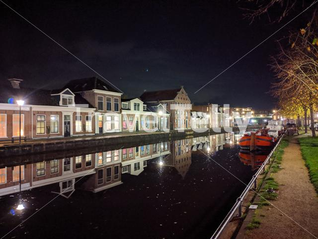 Housing along the canal at night in Sneek, Friesland, The Netherlands