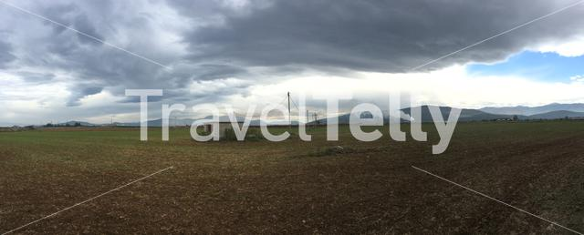 Panorma from a factory and dark clouds around Neos Platanos in Greece