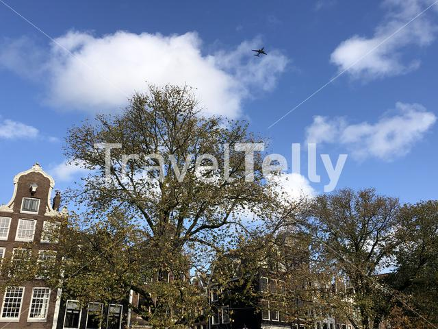 Airplane flying over the old town of Amsterdam, The Netherlands
