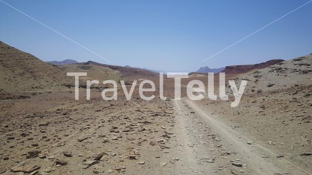 Gravel road through the desert in Namibia