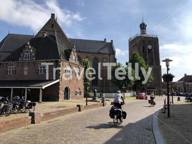 Tourist cycling through downtown Workum in Friesland