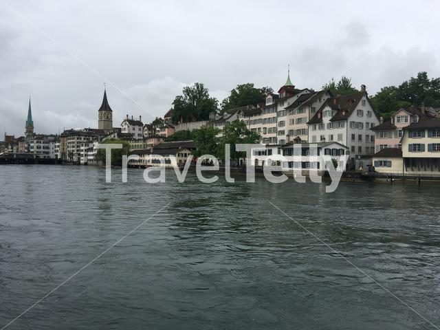View from the Limmat river with the St. Peter and Fraumünster Church in Zurich Switzerland