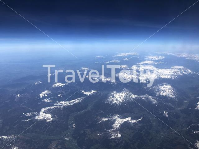Flying over the snowy alps in Europe