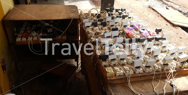 Phone chargers at the town Koundara in Guinea