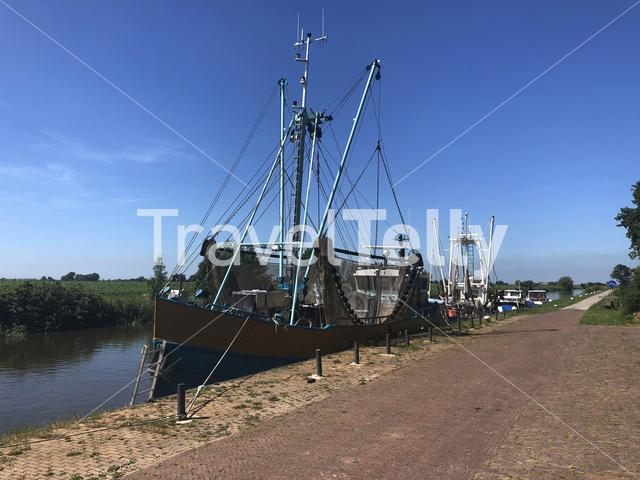 Fishing boats at a canal around Engwierum, Friesland, The Netherlands