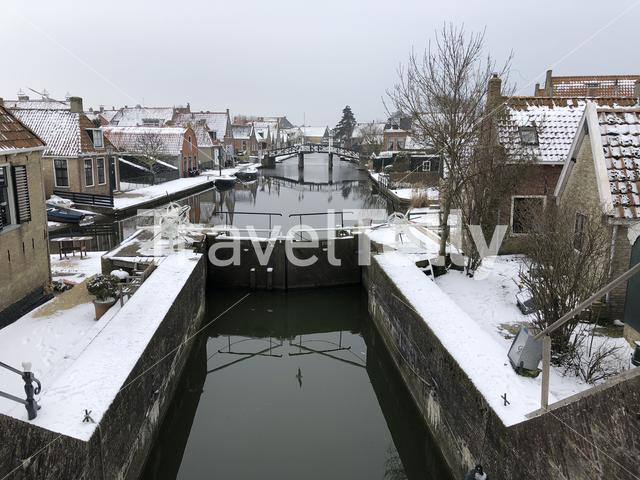 Canal lock in Hindeloopen during winter in Friesland The Netherlands
