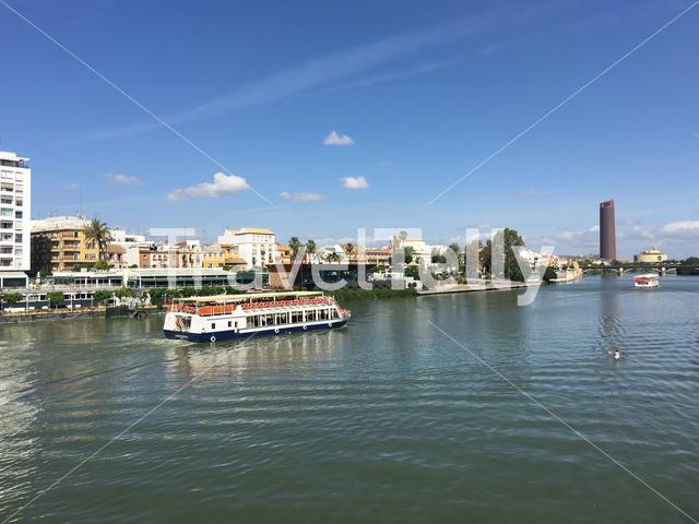 Cruise at the Canal de Alfonso XIII seen from Puente de S. Telmo in Seville Spain