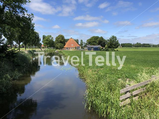 Canal towards the village Easterwierrum in Friesland The Netherlands
