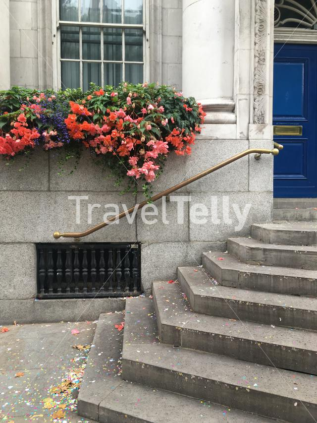 Entrance to a city wedding venue with confetti on the ground
