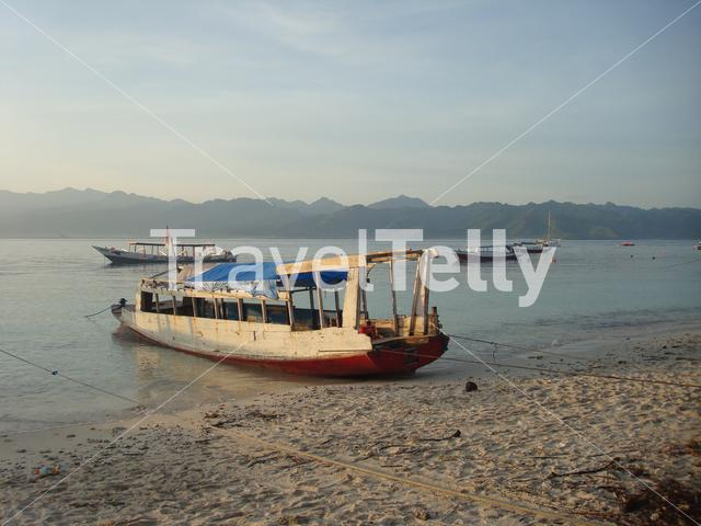 Gili Trawangan with a long-tail boat at the beach in the morning