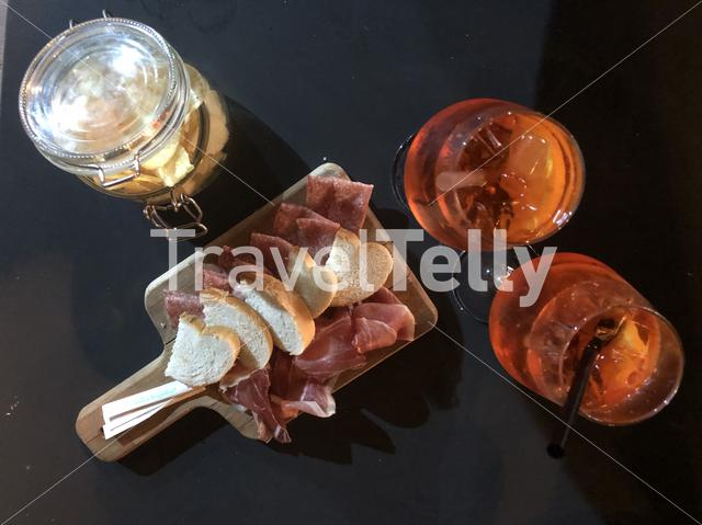 Spritz cocktails with some meat and chips in Trieste Italy