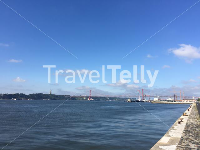 Tagus river with the Ponte 25 Abril and Christ the King statue in Lisbon Portugal