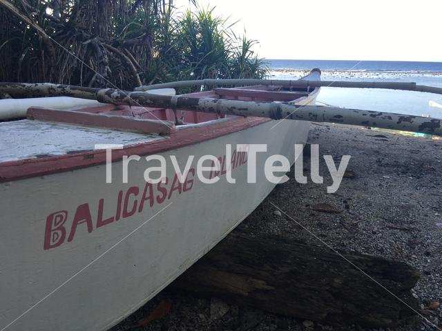 Catamaran Boat with Balicasag Island writing on it at the beach of Balicasag Island in Bohol the Philippines