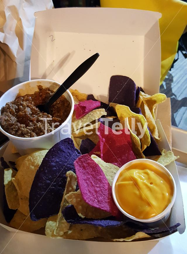 Colorfull nachos with cheese and meat