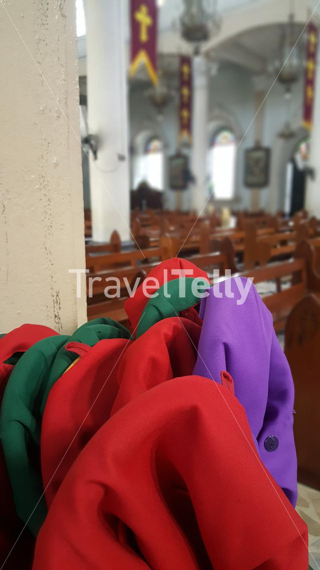 Money collecting belts inside Santo Rosario church in Angeles, Philippines