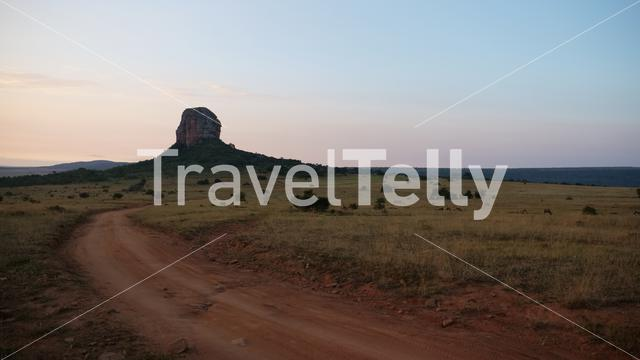 Dirt road with a big rock landscape in Waterberg South Africa