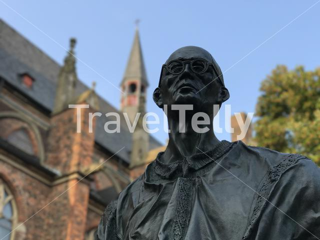Statue from Karl Leisner a Roman Catholic priest next to the Propstei and Stiftskirche St. Mariä Himmelfahrt church in Kleve germany