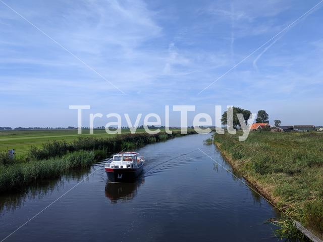 Boat on a canal inbetween Friesland and Overijssel in The Netherlands