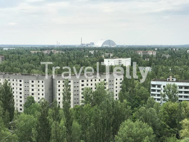 Buildings in Pripyat the abandoned city with the Chernobyl power plant in the background