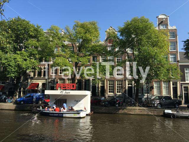 Tourism at a snack corner in the canals of Amsterdam The Netherlands