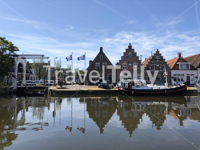 Houses next to the canal in the old town of Makkum, Friesland, The Netherlands