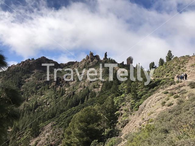 Tourists walking towards the Roque Nublo a volcanic rock on the island of Gran Canaria