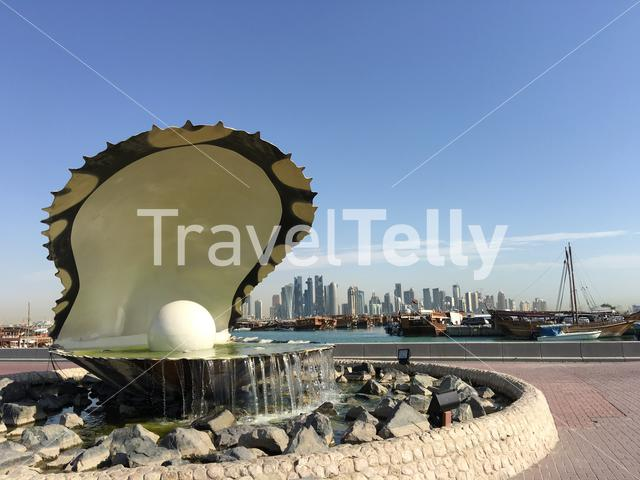 The Pearl Monument and fountain located along the Dhow Harbour on the Corniche in Doha Qatar