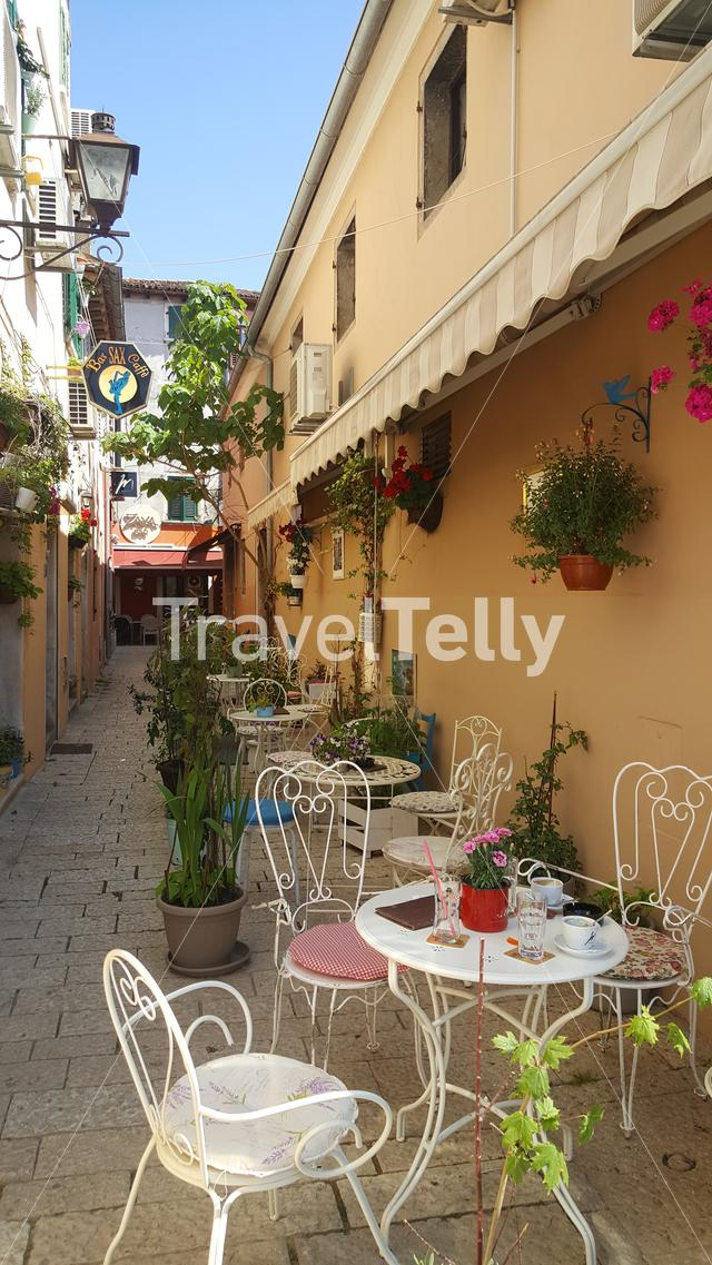 Small street with tables and chairs in old town Rovinj, Croatia