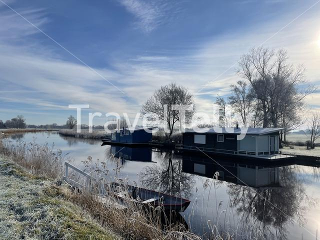 Floating homes around Aldeboarn during a winter day in Friesland The Netherlands