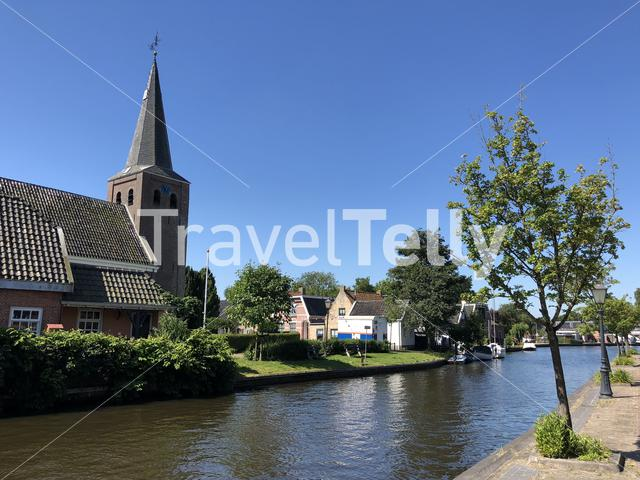 Church next to the canal in Warten, Friesland The Netherlands