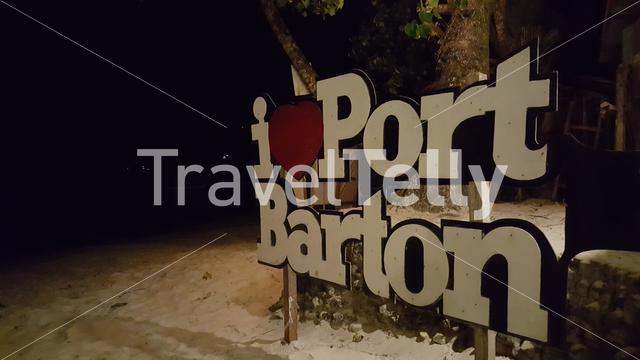 I Love Port Barton sign on beach at night