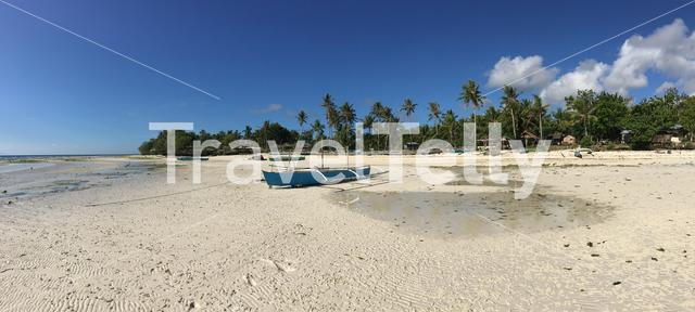 Panorama from a blue catamaran boat with reflection at Anda beach in the morning during low tide in Bohol Island the Philippines