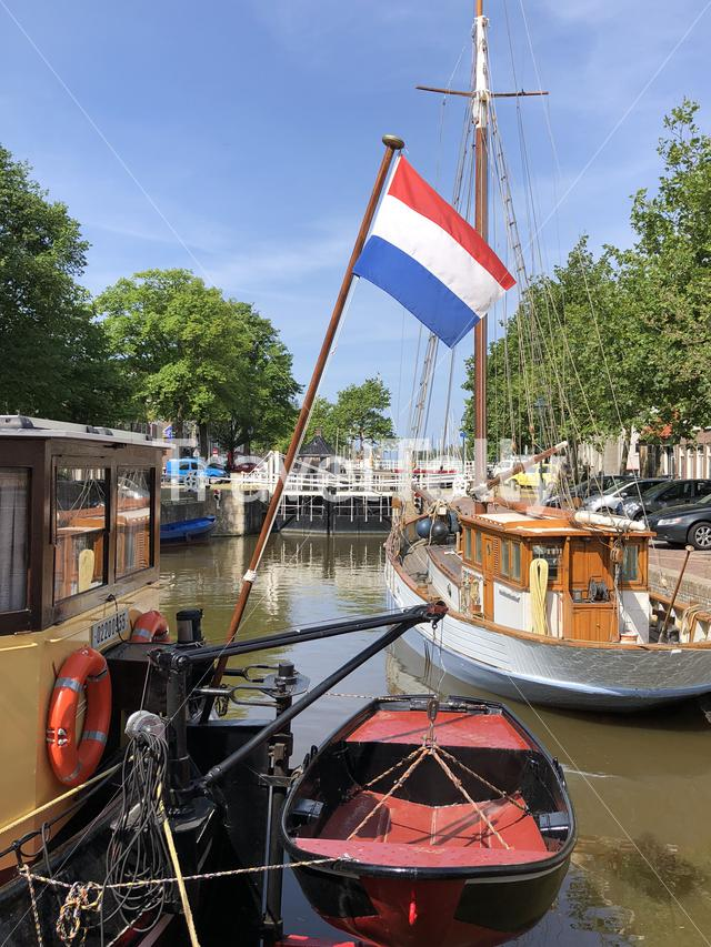 Boats in a canal in Harlingen, Friesland, The Netherlands
