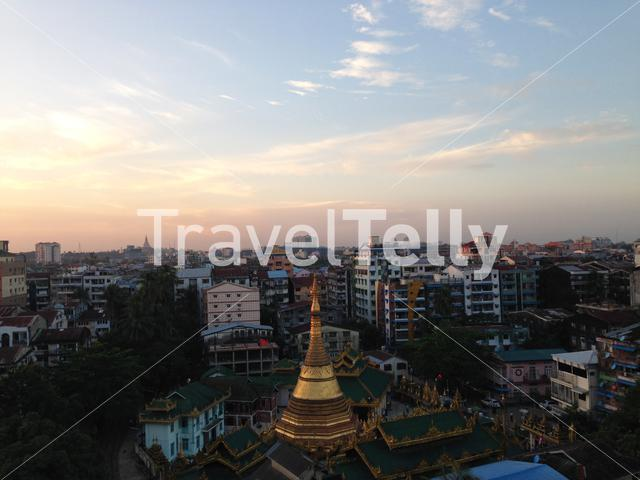 Yangon city view with the Shwe Phone Pwint Pagoda during sunset in Myanmar