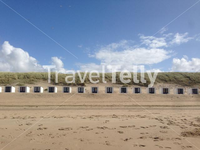 Small beach houses in front of the dunes at Texel, The Netherlands