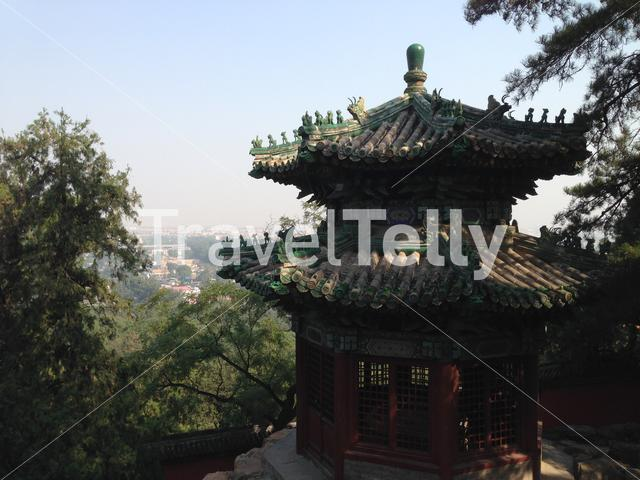 The Summer Palace royal park with the at the background the cityscape of Beijing China