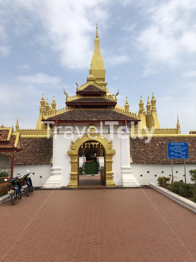 Entrance to the Gold Buddhist stupa Pha That Luang Vientiane in Laos