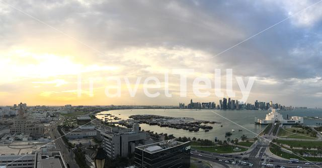 Panorama of an overview of the Dhow Harbour with the Museum of Islamic Art on the Corniche during sunset in Doha Qatar