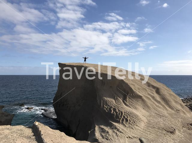 Guy stands on a big rock at San Miguel de Tajao in Tenerife